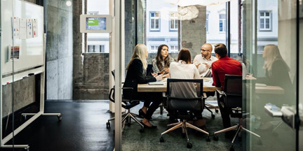 a group of professionals in a conference room engaging in a discussion