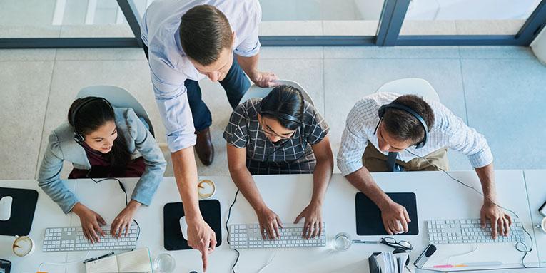 people working on office desk