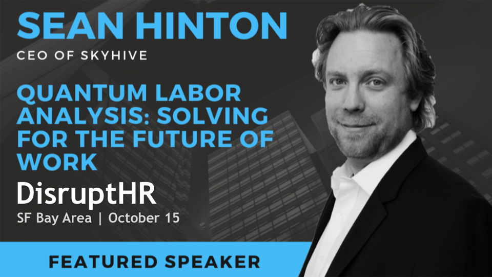 ceo Sean Hinton in front of a background with text that reads                                  'quantum labor analysis: solving for the future of work. Disrupt HR, SF Bay Area, October 15'